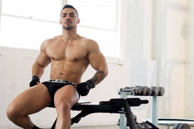 Model Arad Winwin poses shirtless in a gym