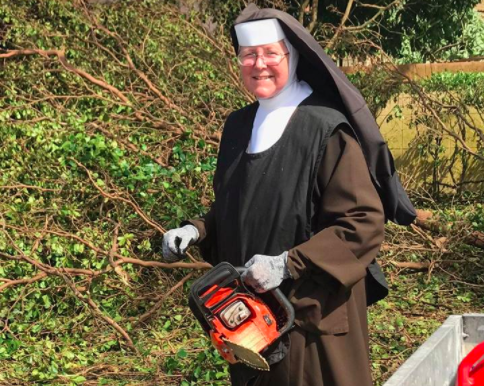 Sister Margaret Ann holding a chainsaw