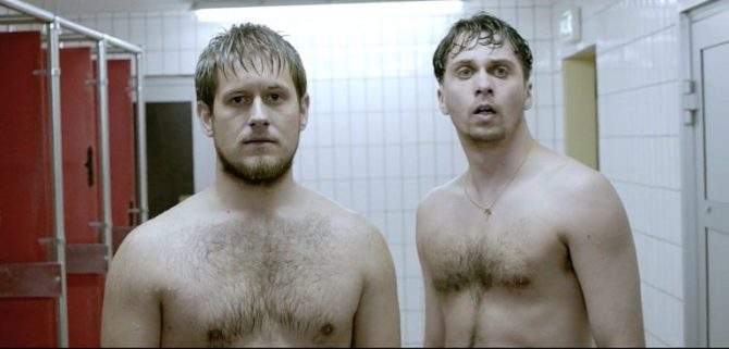 Actors Svend Erichsen and Per Magnus Barlaug standing in a locker room.