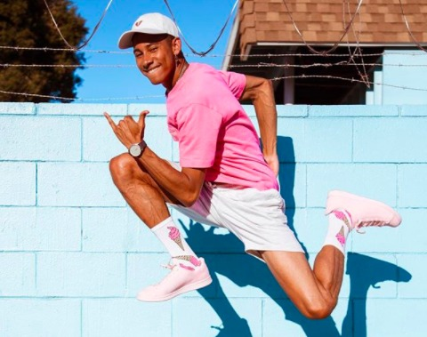 Keiynan Lonsdale jumping in front of barbed wire