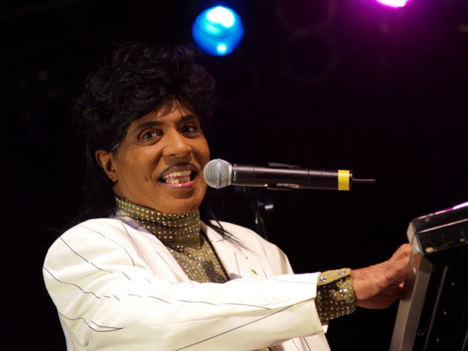 Little Richard singing and playing the piano