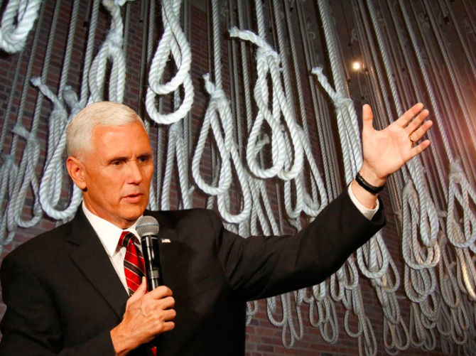 Mike Pence standing in front of a roomful of nooses waiting to hang the gays