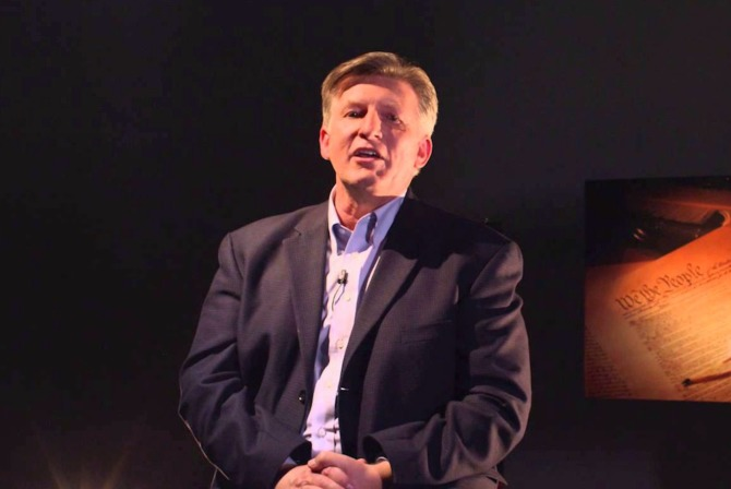 Christian extremist Rick Wiles speaking to the camera