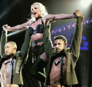 A Britney Spears fan made the pop diva crack a smile and laugh during her show
