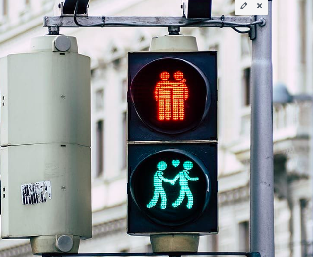 A walk sign in Vienna that showcasing two gay men as the stop and go icons.