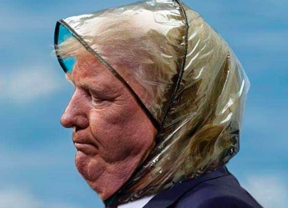 Donald Trump wearing a ladies rain cap