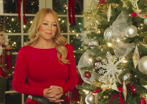 Mariah Carey holding a wine glass