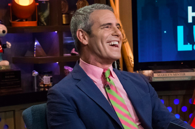 Andy Cohen hosting his show and smiling