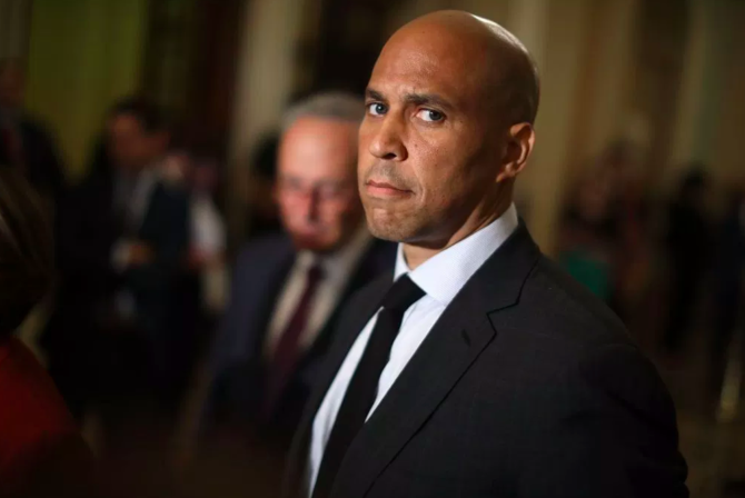 Cory Booker in a black suit and tie