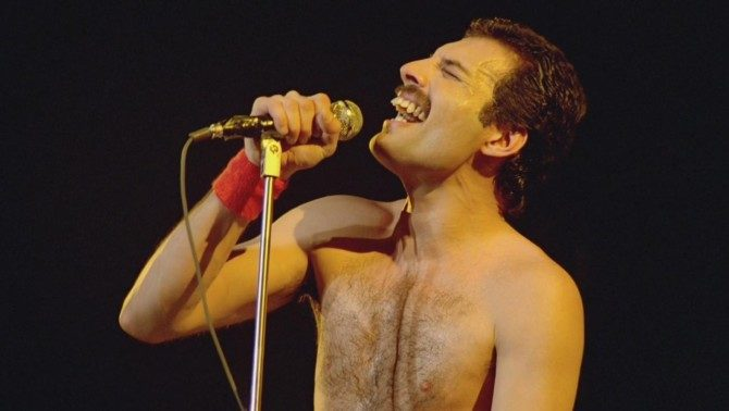 Late Queen frontman Freddie Mercury singing into a microphone