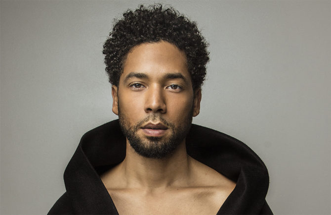 Jussie Smollett against a grey background
