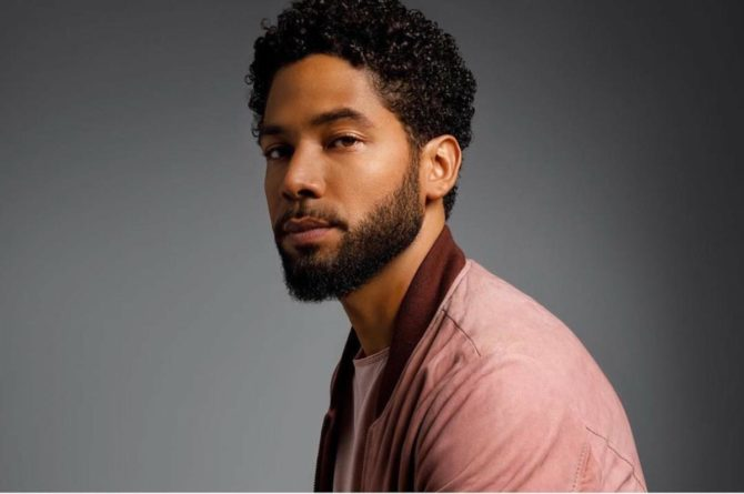 Jussie Smollett in a pink shirt