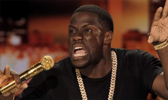 Kevin Hart holding a gold microphone