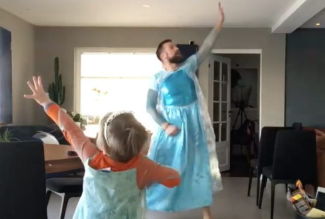 Father and son twirl to Disney's