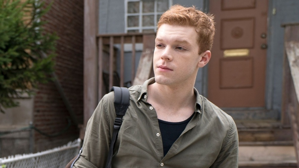 Cameron Monaghan, who plays the gay character Ian on Shameless, poses with a backback in Chicago.