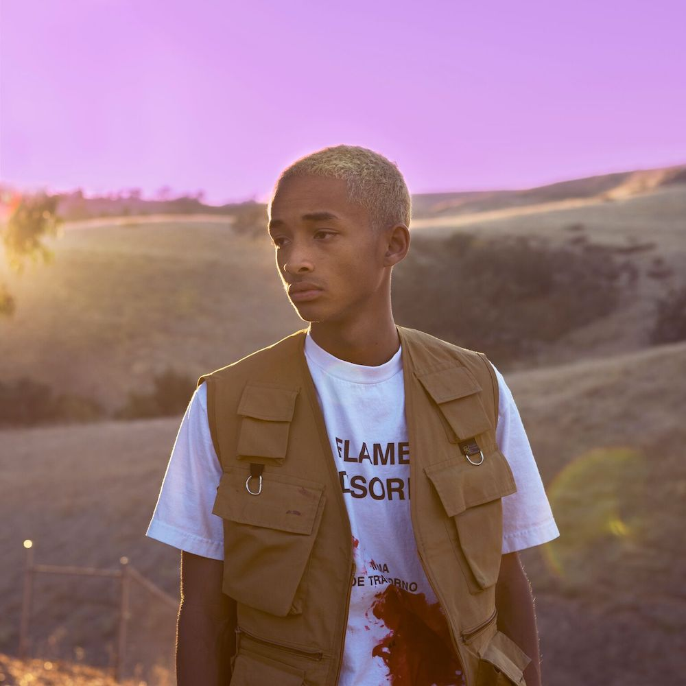 Jaden Smith poses in a queer, fashion-forward vest against a purple sunset.