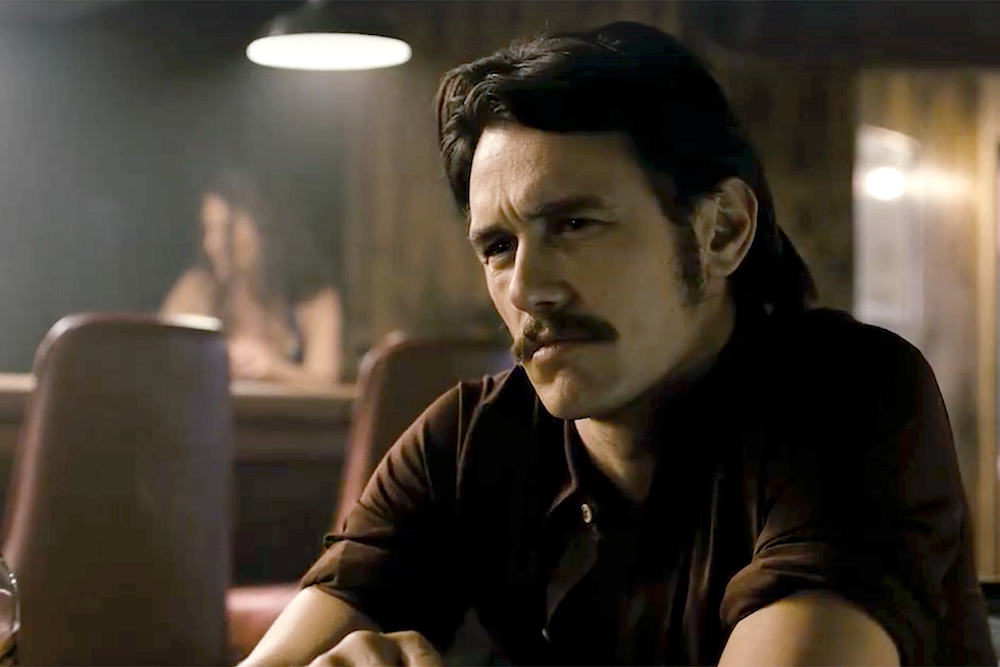 James Franco, who has played several gay characters, poses as one in this shot in an old-fashioned bar.