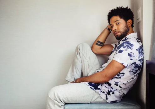 Jussie Smollet white pants and equality tattoo