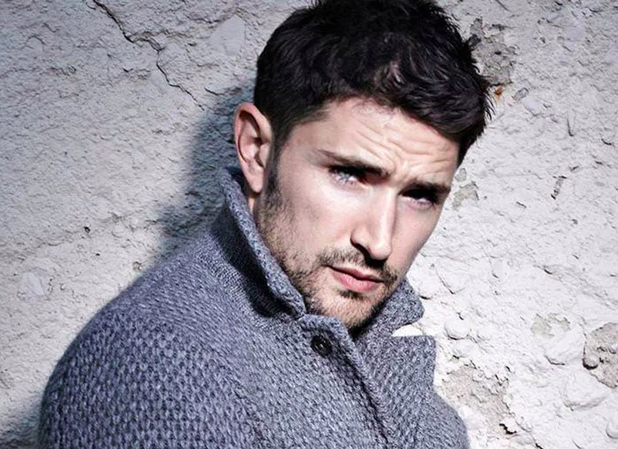 Matt Dallas in a grey sweater