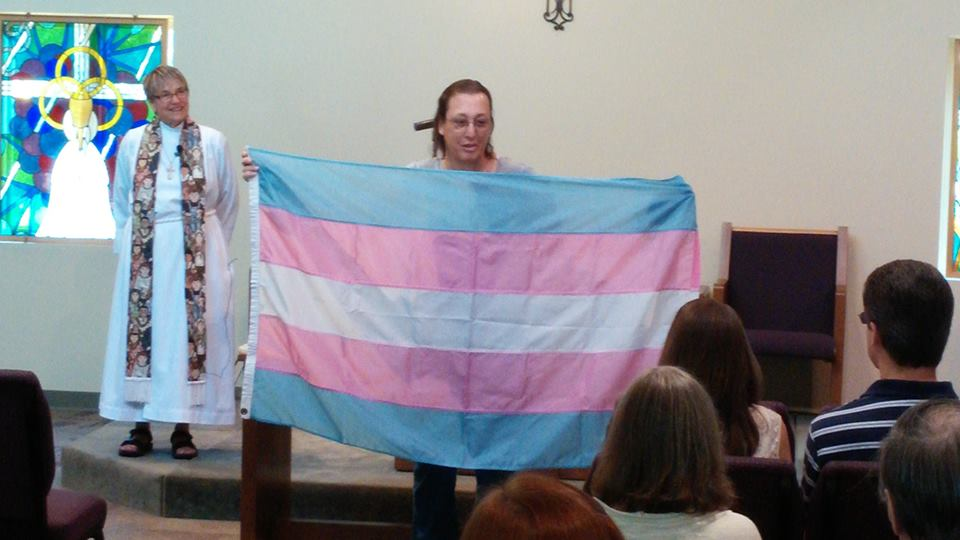 Monica Helms displaying the Transgender Pride Flag