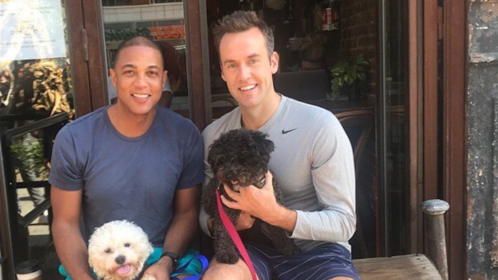Don Lemon and Tim Malone and their dogs,