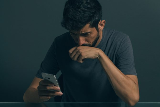 Man crying into his phone