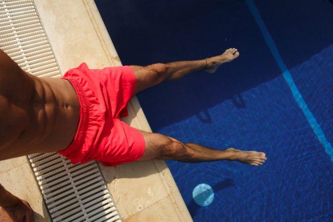 Man's legs by pool