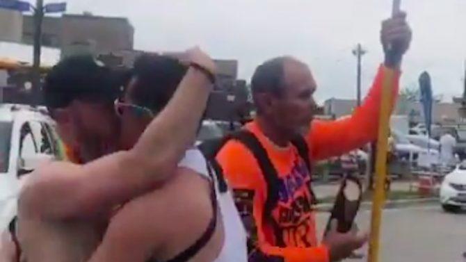 kissing at pride, counter protestor