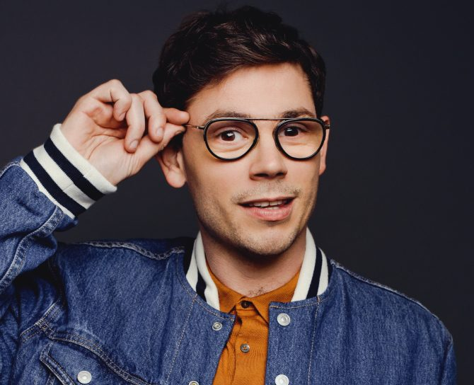 Ryan O'Connell in a jacket