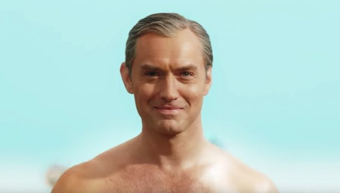 Jude Law and his tiny speedo turn heads on the beach
