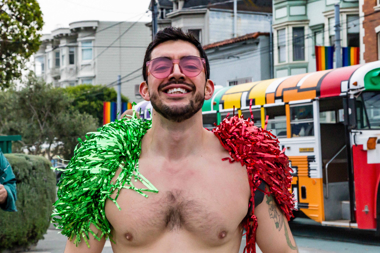 A man in a red and green scarf at the Santa Skivvies Run in San Francisco.