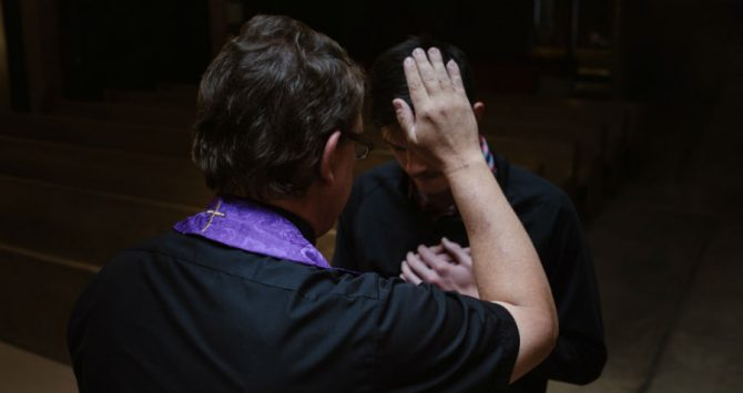 A priest hears confession