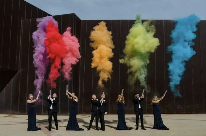 The wedding party release smoke flares