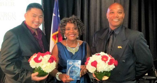 Phillip and Tony Tsai-Brooks with the Mayor of Live Oak, Texas, Mary Dennis