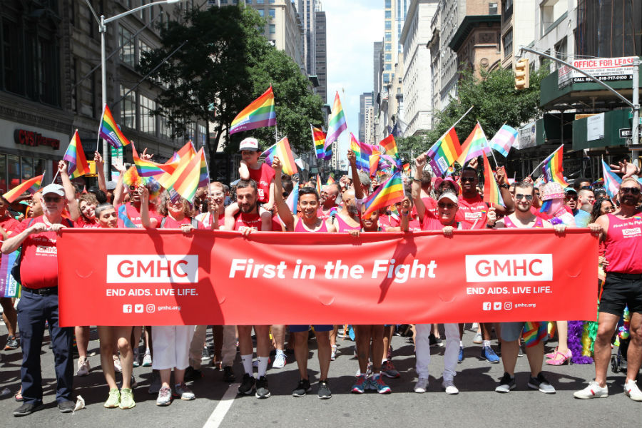 Kelsey Louie (center) marches with GMHC at New York Pride