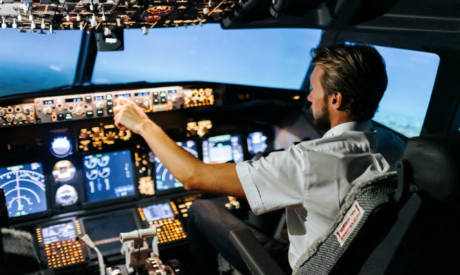 An airline pilot in a cockpit