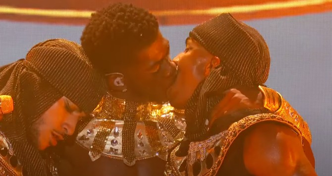 Lil Nas X kisses one of his dancers at the BET Awards