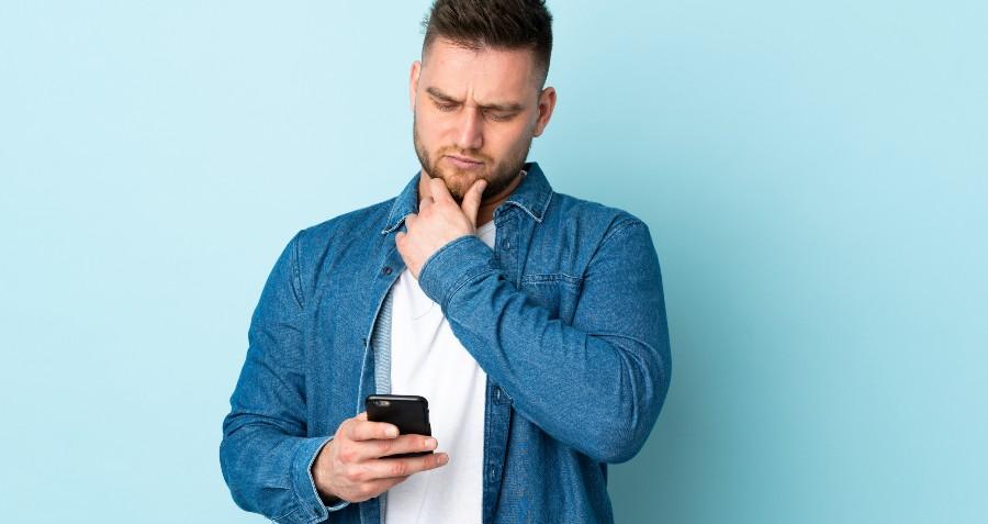 A man checks his cellphone