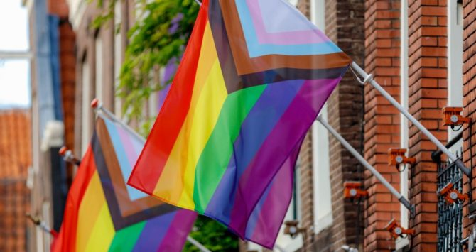 A Progress Flag for LGBTQ rights outside a building