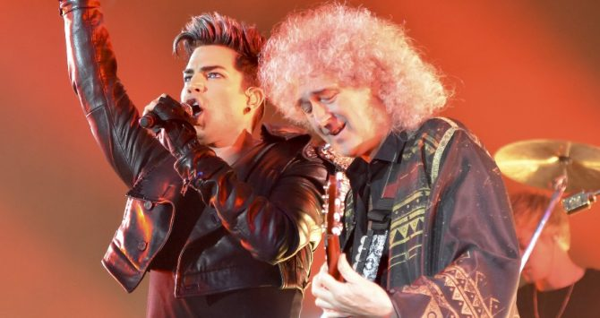 Adam Lambert and Brian May on stage together at a Queen concert