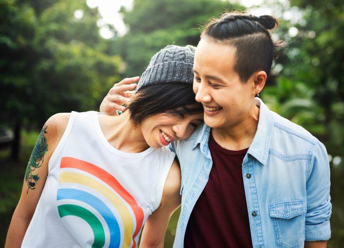 Lesbian couple with rainbow pride shirt