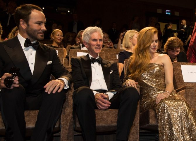 Tom Ford and his husband Richard Buckley, alongside actress Amy Adams, at a screening in 2016 at the Venice Film Festival